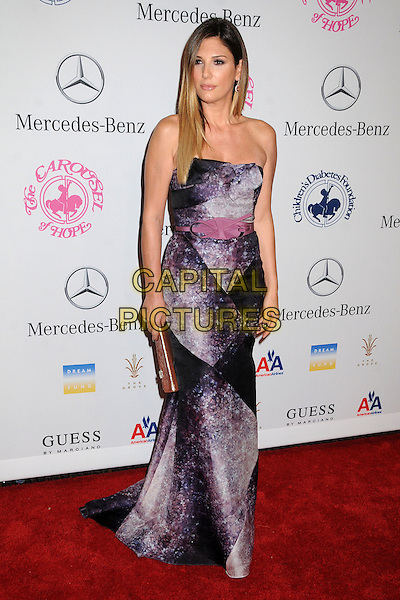 Daisy Fuentes.26th Annual Carousel of Hope Gala held at the Beverly Hilton Hotel, Beverly Hills, .California, USA, 20th October 2012..full length dip dye dyed hair ombre strapless grey gray black pink dress purple belt clutch bag .CAP/ADM/BP.©Byron Purvis/AdMedia/Capital Pictures.