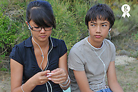 Teenage boy and girl listening to mp3 players (Licence this image exclusively with Getty: http://www.gettyimages.com/detail/91276467 )