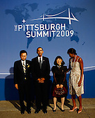 Pittsburgh, PA - September 24, 2009 -- United States President Barack Obama (2L) greets Japanese Prime Minister Yukio Hatoyama (L) while welcoming him to the opening dinner for G-20 leaders as U.S. first lady Michelle Obama (R) escorts Japanese first lady Miyuki Hatayama at the Phipps Conservatory on Thursday, September 24, 2009 in Pittsburgh, Pennsylvania. Heads of state from the world's leading economic powers arrived today for the two-day G-20 summit held at the David L. Lawrence Convention Center aimed at promoting economic growth. .Credit: Win McNamee / Pool via CNP
