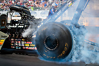 Jul 29, 2018; Sonoma, CA, USA; Detailed view of the Goodyear rear tire on the dragster of NHRA top fuel driver Tony Schumacher as he does a burnout during the Sonoma Nationals at Sonoma Raceway. Mandatory Credit: Mark J. Rebilas-USA TODAY Sports