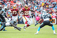 Landover, MD - October 14, 2018: Washington Redskins running back Adrian Peterson (26) avoids a tackle during the  game between Carolina Panthers and Washington Redskins at FedEx Field in Landover, MD.   (Photo by Elliott Brown/Media Images International)