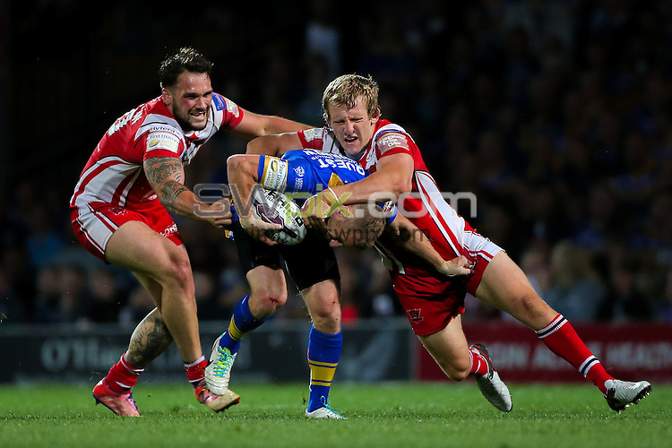 Picture by Alex Whitehead/SWpix.com - 02/09/2016 - Rugby League - First Utility Super League - Leeds Rhinos v Salford Red Devils - Headingley Carnegie Stadium, Leeds, England - Leeds' Rob Burrow is tackled by Salford's George Griffin and Logan Tomkins.