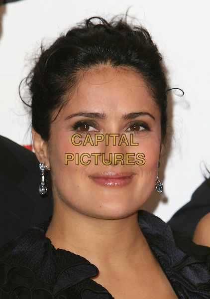 SALMA HAYEK.2007 NCLR ALMA Awards - Press Room held at the Pasadena Civic Center, Pasadena, California, USA..June 1st, 2007.headshot portrait dangling earrings.CAP/ADM/CH.©Charles Harris/AdMedia/Capital Pictures *** Local Caption *** .