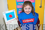Maeve Godley who is a pupil at Scoil Naomh Eirc in Kilmoyley has her art work featured in the 2012 Colgate calendar following her win in the national art competition.
