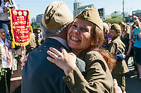 Moscow, Russia, 09/05/2013..A well-wisher wearing Soviet era army uniform hugs a Russian World War Two veteran in Gorky Park during the country's annual Victory Day celebrations.
