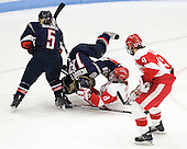 Casey Knajdek (UConn - 5), Rebecca Hewett (UConn - 18), Kayla Tutino (BU - 8), Jenn Wakefield (BU - 9) - The Boston University Terriers defeated the visiting University of Connecticut Huskies 4-2 on Saturday, November 19, 2011, at Walter Brown Arena in Boston, Massachusetts.