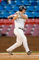 Mike Murray #15 of the Wake Forest Demon Deacons follows through on his swing against the North Carolina State Wolfpack at Wake Forest Baseball Park March 19, 2010, in Winston-Salem, North Carolina.  Photo by Brian Westerholt / Four Seam Images