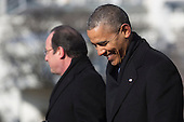 United States President Barack Obama, right, smiles as President Francois Hollande of France speaks during an arrival ceremony on the South Lawn of the White House in Washington, D.C., U.S., on Tuesday, Feb. 11, 2014. <br /> Credit: Andrew Harrer / Pool via CNP