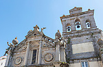 Sixteenth century church of Igreja de Nossa Senhora de Graca, Evora, Alto Alentejo, Portugal, southern Europe built in Italian Renaissance style facade having a portico with Tuscan columns architectural designs by Miguel de Arruda. Two stone Atlas-like figures sit on each corner nicknamed by locals the 'children of Grace'