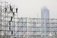 Workers build up a scaffolding at the Olympic Sailing Center in Qingdao, China. Qingdao will host the sailing events of the 2008 Beijing Olympics...