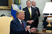 US President Donald J. Trump (C) delivers remarks as US Secretary of State Mike Pompeo (Back C) looks on; during a meeting with President of Italy Sergio Mattarella (not pictured) in the Oval Office of the White House in Washington, DC, USA, 16 October 2019. The leaders meet to discuss a wide variety of economic and security issues such as telecommunications security, the NATO alliance and the Turkish incursion into Syria.<br /> Credit: Michael Reynolds / CNP