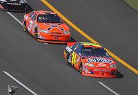 Apr 29, 2007; Talladega, AL, USA; Nascar Nextel Cup Series driver Jeff Gordon (24) leads Jeff Burton (31) during the Aarons 499 at Talladega Superspeedway. Mandatory Credit: Mark J. Rebilas