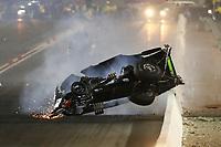 Nov 1, 2019; Las Vegas, NV, USA; NHRA top alcohol funny car driver Doug Gordon crashes during qualifying for the Dodge Nationals at The Strip at Las Vegas Motor Speedway. Gordon would be uninjured in the crash. Mandatory Credit: Mark J. Rebilas-USA TODAY Sports
