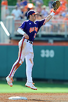 Second Baseman Steve Wilkerson #17 leaps to field a throw from the catcher during a  game against the Miami Hurricanes at Doug Kingsmore Stadium on March 31, 2012 in Clemson, South Carolina. The Tigers won the game 3-1. (Tony Farlow/Four Seam Images)..