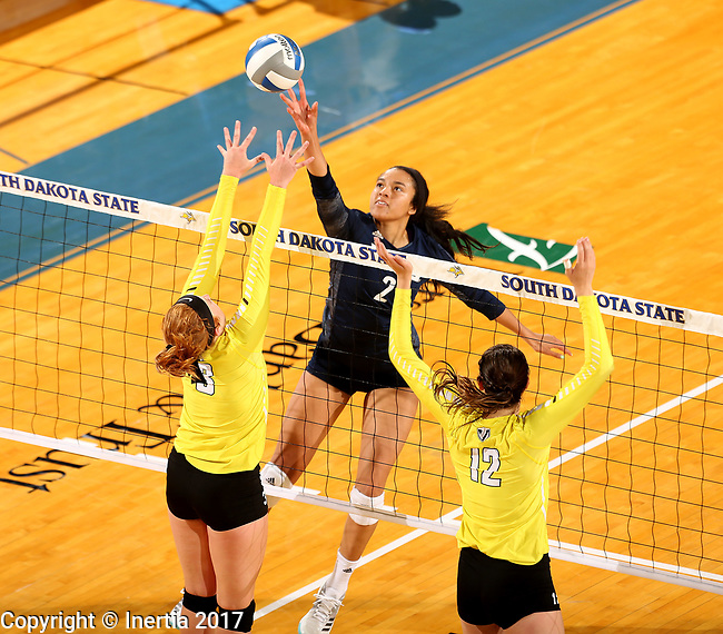 BROOKINGS, SD - SEPTEMBER 1: Victoria Ewalefo #2 from Northern Arizona tips the ball past Alana Brown #8 and Taylor Graboski #12 from Valparaiso during their match Friday afternoon at the Jackrabbit Invitational at Frost Arena in Brookings. (Photo by Dave Eggen/Inertia)