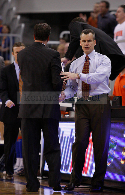 UK head Coach John Calipari and Florida Head Coach Billy Donovan shake hands during the second half of the University of Kentucky's men basketball game against University of Florida 3/4/12 at the O'Connell Center in Gainesville, Fl. Photo by Quianna Lige | Staff