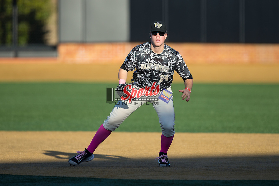Wake Forest Demon Deacons first baseman Gavin Sheets (24) on defense against the Virginia Tech Hokies in game two of a doubleheader at Wake Forest Baseball Park on March 7, 2015 in Winston-Salem, North Carolina.  (Brian Westerholt/Sports On Film)