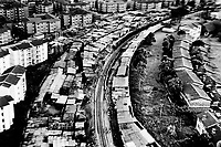 The railway track that runs along the edge of Kibera. Over 25 percent of Nairobi's population live in Kibera, an area that covers less than one percent of the city. Although the population of the slum is over one million, it is recognised officially as a 'squat', or illegally occupied land, which allows the government to ignore the basic needs of the inhabitants.