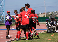 Keven Aleman (10) of Canada celebrates his goal with teammates during the quarterfinals of the CONCACAF Men's Under 17 Championship at Catherine Hall Stadium in Montego Bay, Jamaica. Canada defeated Trinidad & Tobago, 2-0.