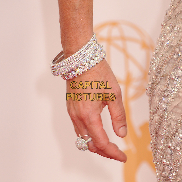 Roma Downey's hand<br /> 65th Annual Primetime Emmy Awards - Arrivals held at Nokia Theatre L.A. Live, Los Angeles, California, USA.<br /> September 22nd, 2013<br /> detail ring bracelets diamond jewellery jewelry grey gray silver  <br /> CAP/ADM/BP<br /> &copy;Byron Purvis/AdMedia/Capital Pictures