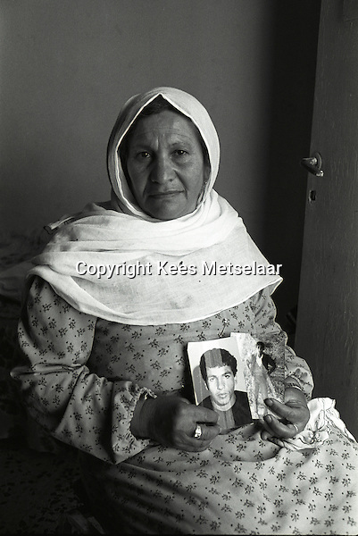 Israel, March and April 1987  ..A trip through Israel and its occupied territories during the first Intifada, Palestinian uprising in 1987. Palestinian mother showing photos of her imprisoned son. ..Photo Kees Metselaar