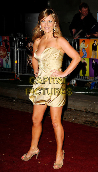 "GERI HALLIWELL.""The Boat That Rocked"" world film premiere at The Odeon, Leicester Square, London, England..March 23rd, 2009.full length gold strapless mini dress cleavage hands on hips tanned low cut silk satin open toe shoes.CAP/CAN.©Can Nguyen/Capital Pictures."
