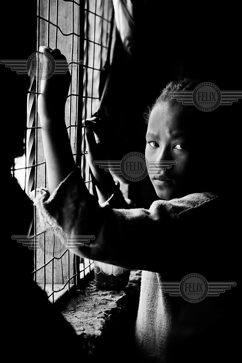A young girl looks out over the Kibera slum.