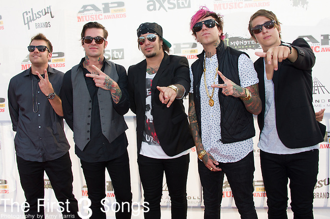 Chris Fronzak, Chris Linck, Sean Heenan, Nate Salameh, and Kalan Blehm of Attila attends the 2014 AP Music Awards at the Rock And Roll Hall Of Fame and Museum at North Coast Harbor in Cleveland, Ohio.