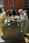 Barbara Chaney Dailey,left, sister of slain civil rights worker James Chaney, and Rita Schwerner Bender, widow of slain civil rights wotker Michael Chaney place a memorial wreath of the headstone outside the Mt.Zion U,M. Church in Philadelphia Ms.Sunday June 19,2005. The church was burned twice by the KKK, to lure the three civil rights owrkers south. The two women placed the flowers on the marker after and emotioanl  memorial service at the Mt. Zion U.M. Church in Philadelphia Ms. Sunday June 19,2005. Sitting next to her is Barbara Chaney Dailey, James Chaney's sister she is holding a program from the memorial service with her brothers photo on it. The memorial service was for the three civil rights workers murdered by the KKK in 1964,James Chaney, Michael Schwerner and Andrew Goodman.Mrs. Bender actually attended two memorail services for her husand Michael Schwerner in Philadelphia,Ms.(Photo/Suzi Altman)