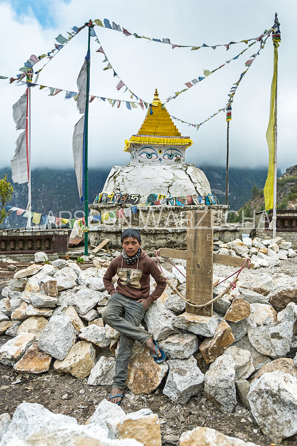 Portrait of Subash Tamang, 11 years old, (finished class 8). <br /> Carrying: 15 kg of stone for the new path with prayer wheels in Namche.) Weight: 30-40 kilo. (Doesn't know exactly.)<br /> Likes playing fotball.