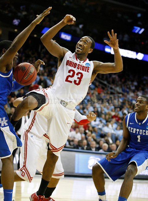 Terrence Jones blocks a shot by David Lighty in the Sweet 16 of the 2011 NCAA Basketball Tournament, at the Prudential Center, in Newark, NJ, on Saturday, March 25, 2011.  Photo by Latara Appleby   Staff
