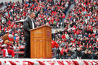 Ohio State Buckeyes head coach Urban Meyer salutes the crowd during the celebration for winning the national championship at Ohio Stadium on Jan. 24, 2015. (Adam Cairns / The Columbus Dispatch)