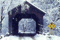 AJ5990, covered bridge, bridge, winter scene, snow, Vermont, Scenic Pine Brook Covered Bridge ca. 1872 on a snowy winter day in Waitsfield in the Mad River Valley in Washington County in the state of Vermont.