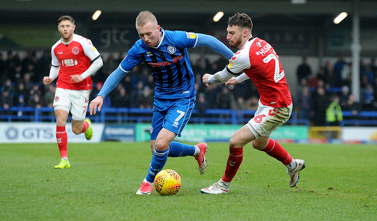 Rochdale's Stephen Dooley battles with Fleetwood Tow's James Husband<br /> <br /> Photographer Hannah Fountain/CameraSport<br /> <br /> The EFL Sky Bet League One - Rochdale v Fleetwood Town - Saturday 19 January 2019 - Spotland Stadium - Rochdale<br /> <br /> World Copyright © 2019 CameraSport. All rights reserved. 43 Linden Ave. Countesthorpe. Leicester. England. LE8 5PG - Tel: +44 (0) 116 277 4147 - admin@camerasport.com - www.camerasport.com