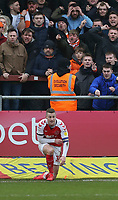 Fleetwood Town's Paul Coutts has a lighter thrown at him by a Blackpool fan<br /> <br /> Photographer Lee Parker/CameraSport<br /> <br /> The EFL Sky Bet League One - Fleetwood Town v Blackpool - Saturday 7th March 2020 - Highbury Stadium - Fleetwood<br /> <br /> World Copyright © 2020 CameraSport. All rights reserved. 43 Linden Ave. Countesthorpe. Leicester. England. LE8 5PG - Tel: +44 (0) 116 277 4147 - admin@camerasport.com - www.camerasport.com