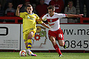 Luke Freeman of Stevenage and Jamie Paterson of Walsall tussle. Stevenage v Walsall - npower League 1 -  Lamex Stadium, Stevenage - 18th September, 2012. © Kevin Coleman 2012.