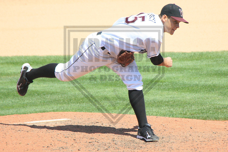 APPLETON - AUGUST 2010: Nick Bucci (15) of the Wisconsin Timber Rattlers, Class-A affiliate of the Milwaukee Brewers, during a game on August 16, 2010 at Fox Cities Stadium in Appleton, Wisconsin. (Photo by Brad Krause)