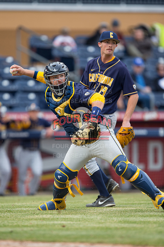 California Golden Bears catcher Brett Cumberland (28) makes a throw to first base against the Duke Blue Devils at Durham Bulls Athletic Park on February 20, 2016 in Durham, North Carolina.  The Blue Devils defeated the Golden Bears 6-5 in 10 innings.  (Brian Westerholt/Four Seam Images)