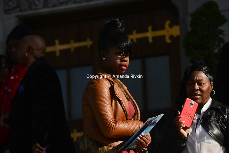 Mourners enter St. Sabina's during the visitation for Tyshawn Lee, 9, who was shot multiple times while playing basketball in an alley on November 2, 2015, in Chicago, Illinois on November 10, 2015. Police allege the killing was a retaliatory gang hit which would mark a new turn in Chicago's gang wars.