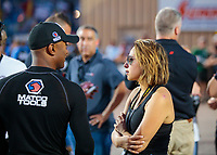 Jul 19, 2019; Morrison, CO, USA; NHRA pro stock motorcycle rider Jianna Salinas (right) talks with Antron Brown during qualifying for the Mile High Nationals at Bandimere Speedway. Mandatory Credit: Mark J. Rebilas-USA TODAY Sports