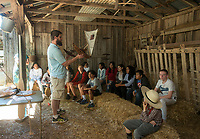 NWA Democrat-Gazette/BEN GOFF @NWABENGOFF<br /> Aaron Loehndorf, collections and educations specialist with the Shiloh Museum of Ozark History, uses a model Marshallese KorKor as he talks to a group of students from Springdale Wednesday, May 9, 2018, as work continues on building a Korkor at the Shiloh Museum of Ozark History in Springdale. Master canoe builder Liton Beasa and his family, in partnership with the Shiloh Museum of Ozark History, began building the two-man Marshallese canoe called a KorKor April 14 and plan to display the finished canoe at the Little Craft Show Saturday in downtown Springdale.
