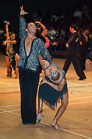 Tomasz Lewandowski and Isabella Olszewska from USA perform their dance during the professional Latin-american competition of the International Championships held in Brentwood Centre, Brentwood, United Kingdom on 13. October 2009. ATTILA VOLGYI
