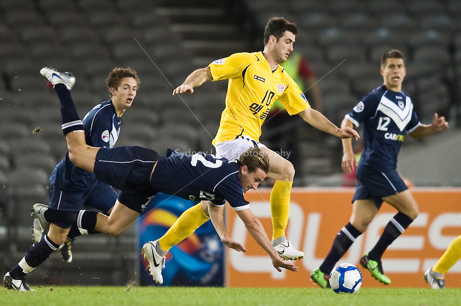 MELBOURNE, AUSTRALIA - MARCH 09, 2010:Nick Ward of Melbourne Victory about to fall onto the ball during the AFC Champions League Group E match between the Melbourne Victory and Seongnam Ilhwa Chunma at Etihad Stadium on March 9, 2010 in Melbourne, Australia. Photo Sydney Low www.syd-low.com