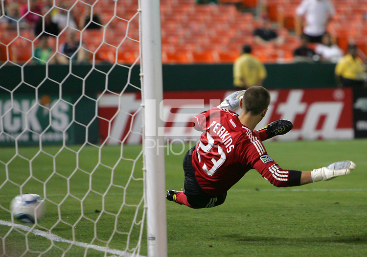 Troy Perkins #23 of D.C. United is beaten by a shot from the penalty spot by Will Johnson #8 for a goal during an Open Cup match against Real Salt Lake at RFK Stadium, on June 2 2010 in Washington DC. DC United won 2-1.