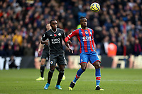 3rd November 2019; Selhurst Park, London, England; English Premier League Football, Crystal Palace versus Leicester City; Wilfried Zaha of Crystal Palace is under pressure from Ricardo Pereira of Leicester City  - Strictly Editorial Use Only. No use with unauthorized audio, video, data, fixture lists, club/league logos or 'live' services. Online in-match use limited to 120 images, no video emulation. No use in betting, games or single club/league/player publications
