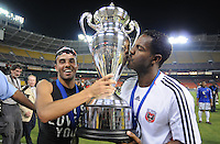 DC United midfielder Fred (7) holds the Lamar Hunt US. Open Cup while team mate forward Luciano Emilio (11) kisses it after the win,DC United defeated The Charleston Battery 2-1, to win the  Lamar Hunt U.S. Open Cup,at RFK Stadium in Washington DC, Saturday September 3, 2008.