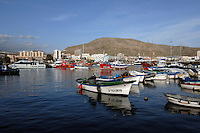 Fishing boats and pleasure boats at anchor,Los Cristianos harbour, Tenerife, Canary Islands.