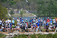 Aaron Wise (USA) and Tiger Woods (USA) walk around the lake to the green on 11 during day 1 of the WGC Dell Match Play, at the Austin Country Club, Austin, Texas, USA. 3/27/2019.<br /> Picture: Golffile | Ken Murray<br /> <br /> <br /> All photo usage must carry mandatory copyright credit (© Golffile | Ken Murray)