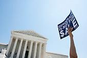 A demonstrator holds a sign up during a press conference outside of the Supreme Court in Washington D.C., U.S. on July 30, 2019. <br /> <br /> Credit: Stefani Reynolds / CNP