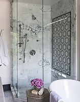 This custom shower features Pembroke, a handmade mosaic shown in  honed Nero Marquina, Bardiglio, Thassos and Carrara, is part of the Silk Road Collection by Sara Baldwin for New Ravenna.<br />